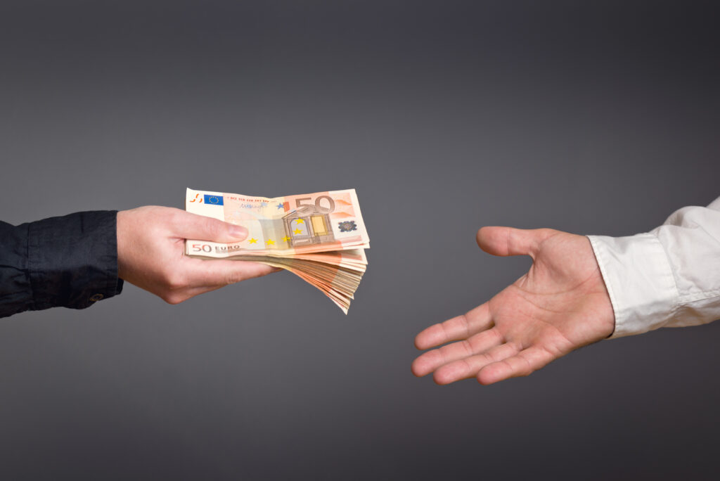 Money Loan. Bank officer loaning stack of euro banknotes money.